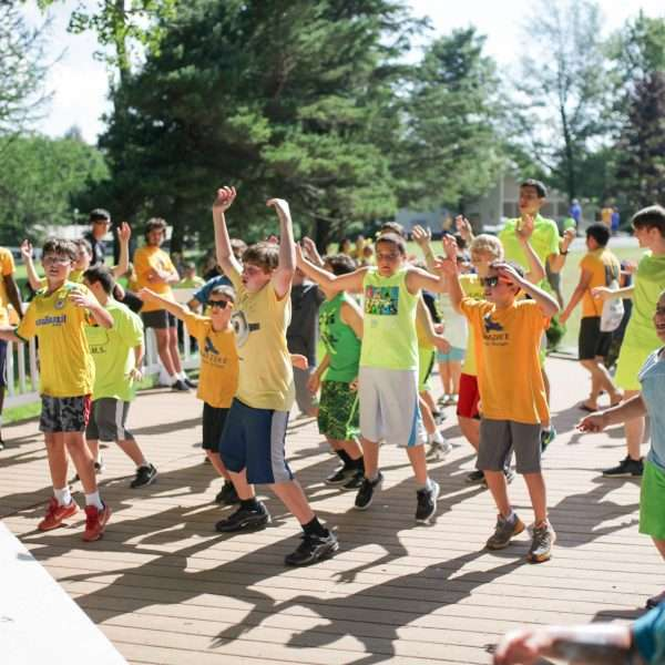 Large group of campers dancing outside