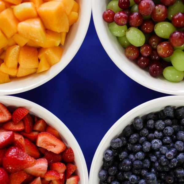 Bowls of chopped fruit from above