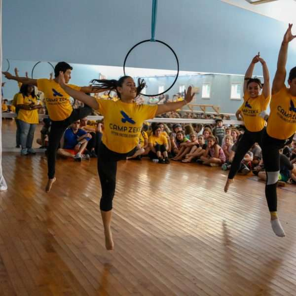 Group of campers rehearing a dance show