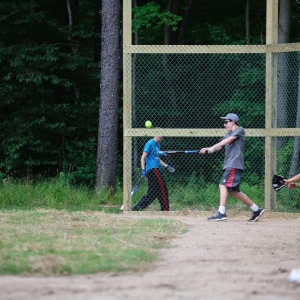 Campers practising baseball