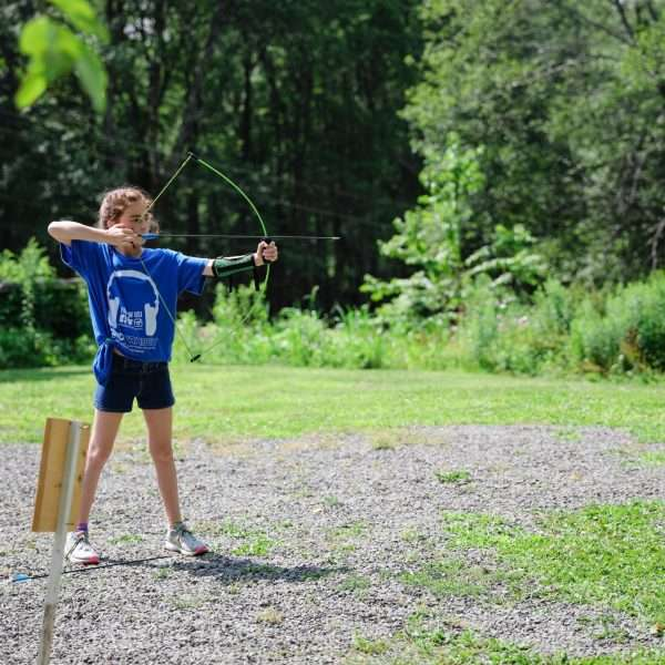 Female camper practising archery