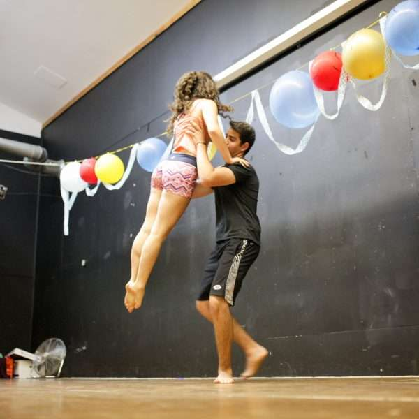 Male and female camper practising a lift in the dance studio