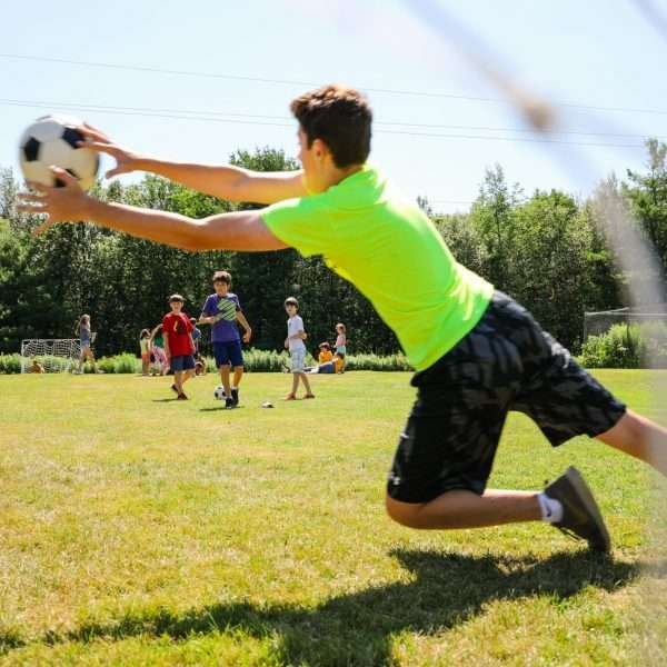 Camper saving a goal during a game of soccer