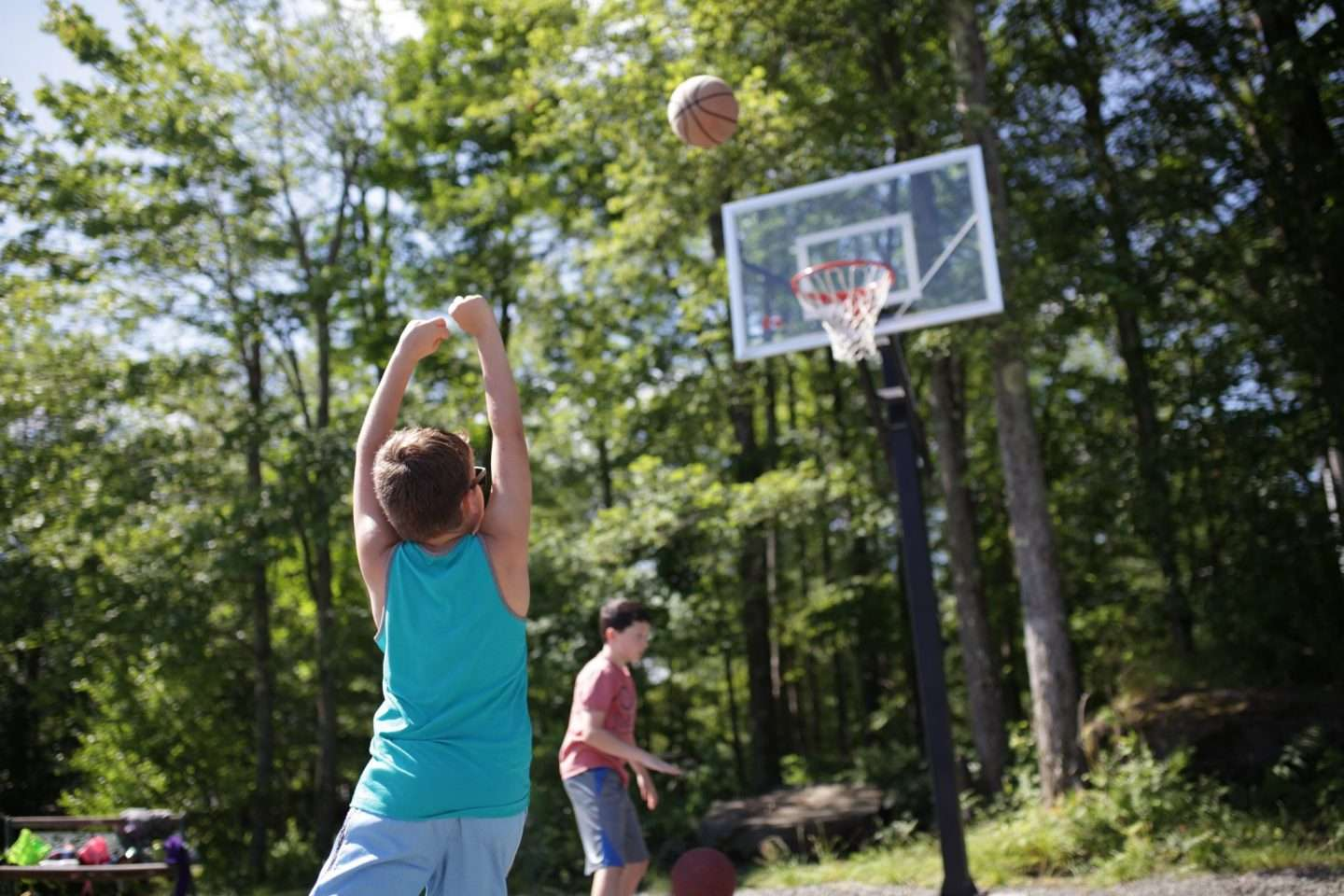 Group of campers playing basketball outside