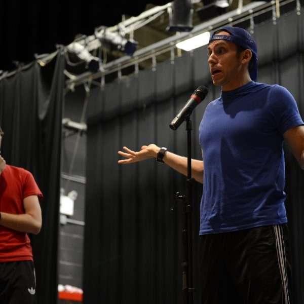 Two male campers performing comedy on stage