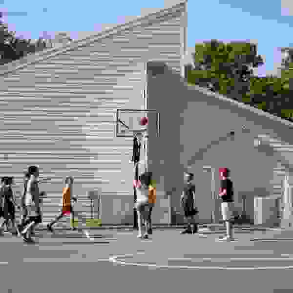 Group of campers playing basketball in the sun