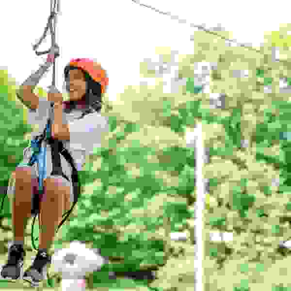 Female camper on the zip line