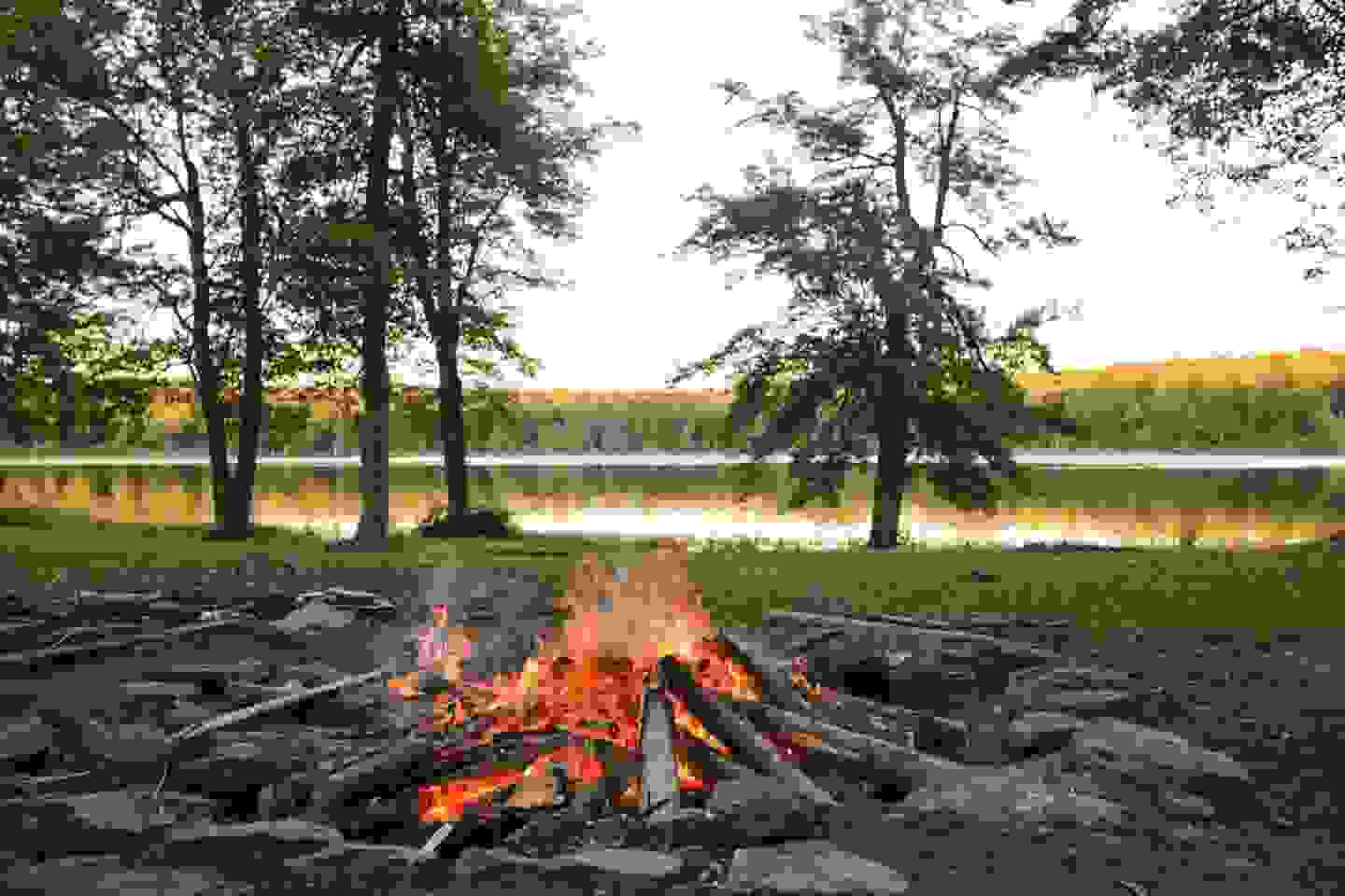 Glowing campfire by the lake