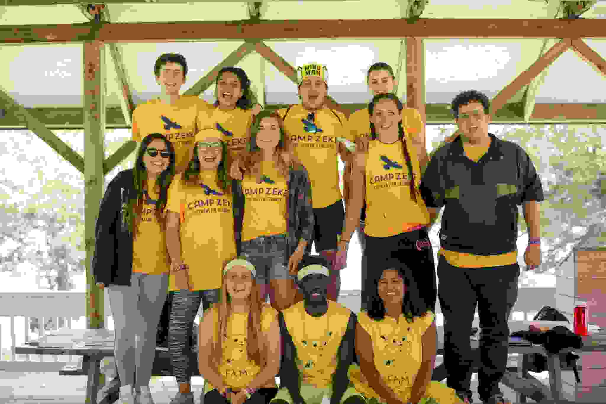 Group of Camp Zeke staff all in yellow camp shirts