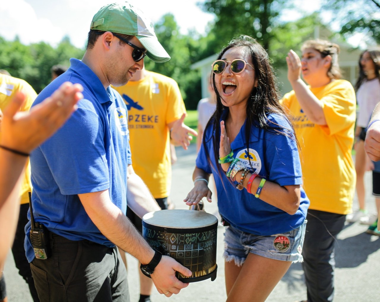 Camp staff playing drums and singing outside