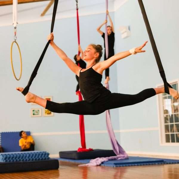 Gymnastic camper on ribbons in the gym