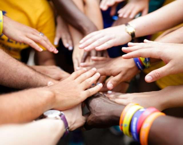 Group of camper's hands joining in the center