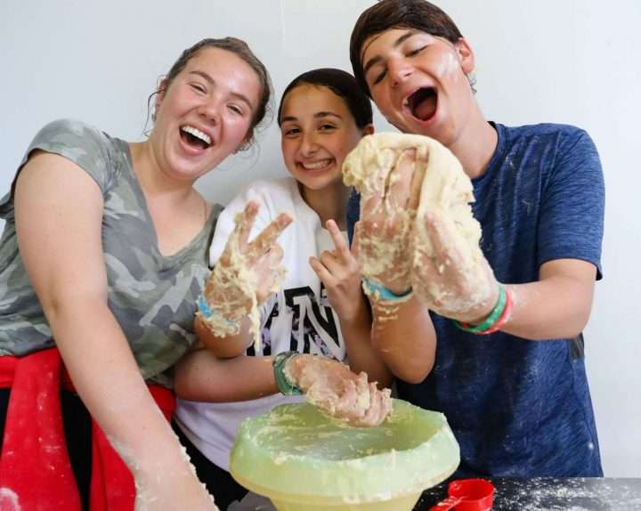 Campers making dough together