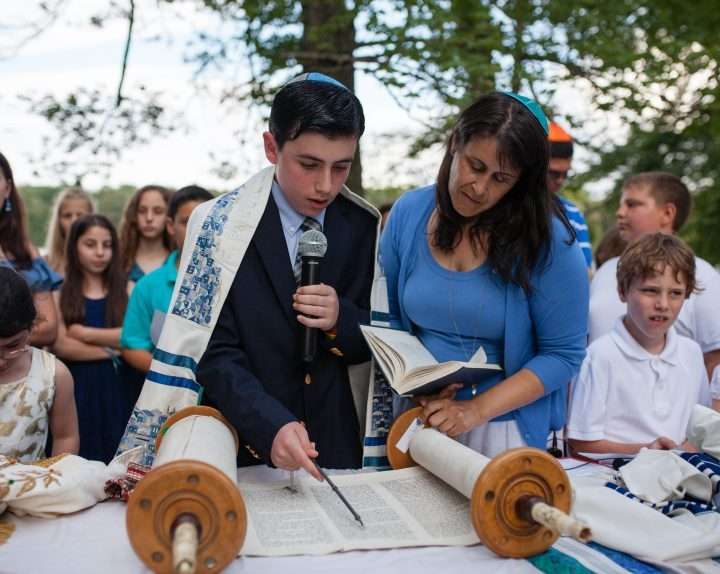 Young man part way through his Barmitzvah