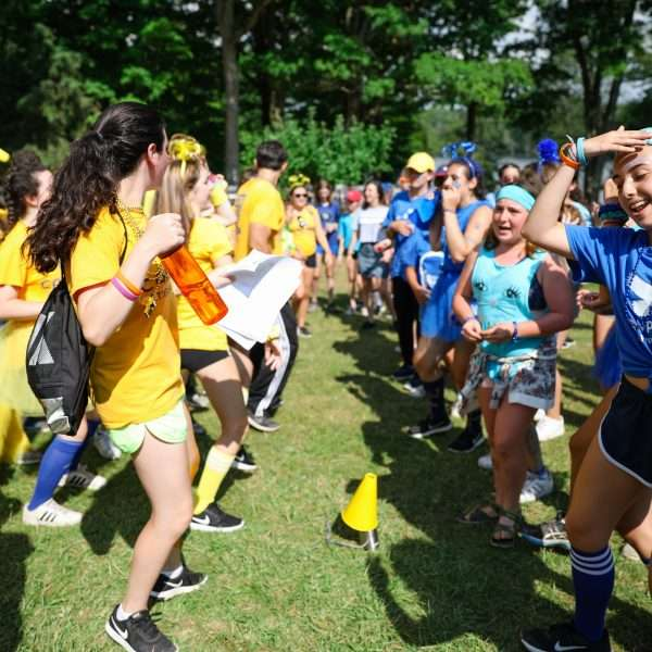 Group of campers wearing either blue or yellow taking part in a color war!