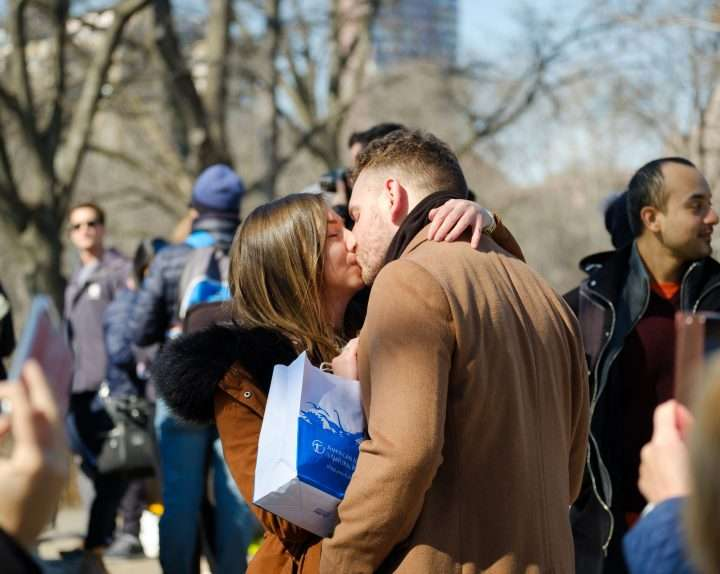 Young couple exchaing a kiss after getting engaged
