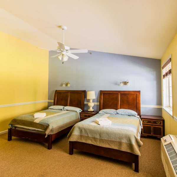 Inside one of the accommodation blocks, showing a large room with two double beds