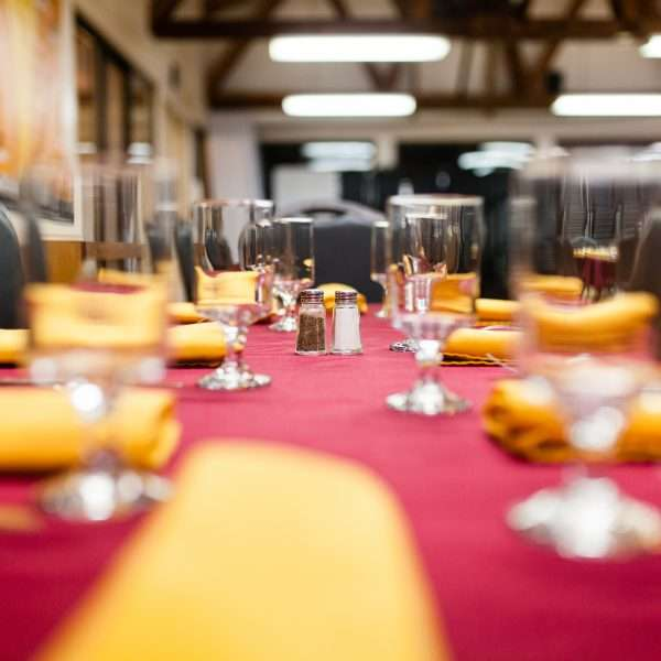 Photo of a table set for dinner, low blurred focus