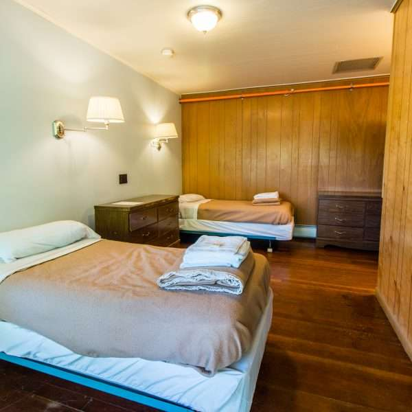 Inside one of the accommodation blocks showing a large room with two double beds