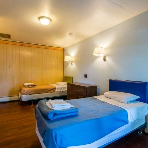 Inside one of the accommodation blocks showing a large room with two single beds