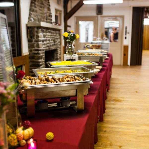 Long table full of freshly prepared food ready for a banquet