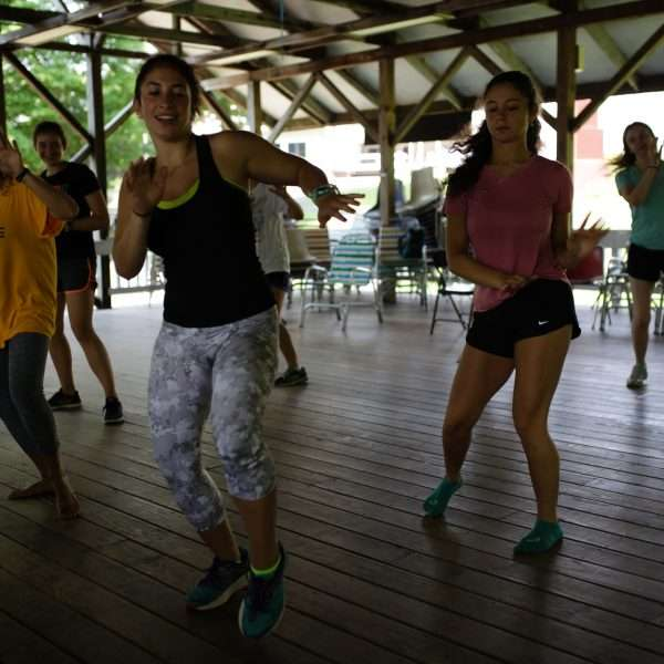 Campers outside in the pavilion taking part in Zumba