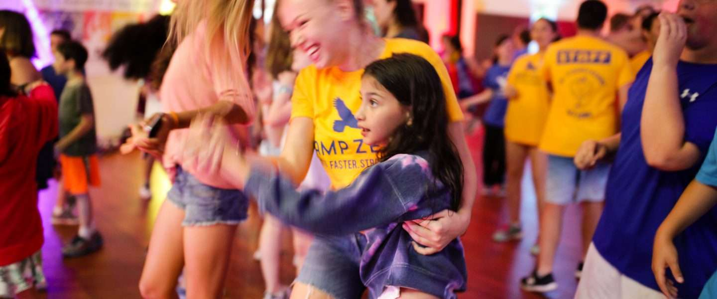 Group of campers smiling during a Zumba rave!