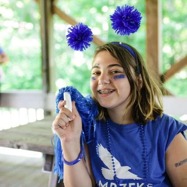 Female camper dressed all in blue